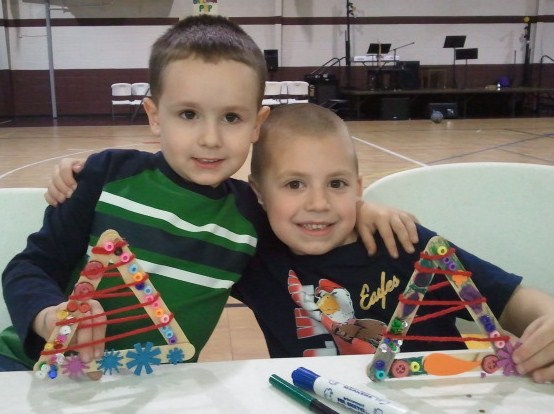 Jackson (right) is with his cousin Evan showing off their Christmas tree creations
