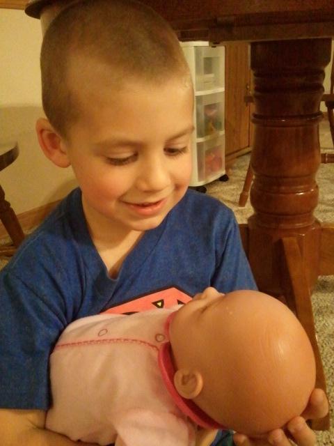 Jackson pretends to be Joseph holding baby Jesus