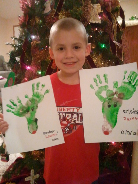Jackson holds his and Lauren's reindeer, made out of foot and hand prints.