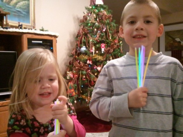 Lauren and Jackson can't wait to turn out the lights to play with their glow sticks.