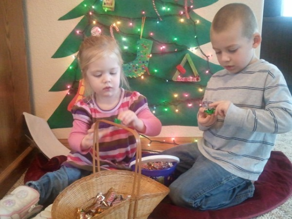 Lauren and Jackson sample the spoils of our Christmas candy hunt.