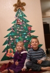 Lauren and Jackson sit under the paper tree.