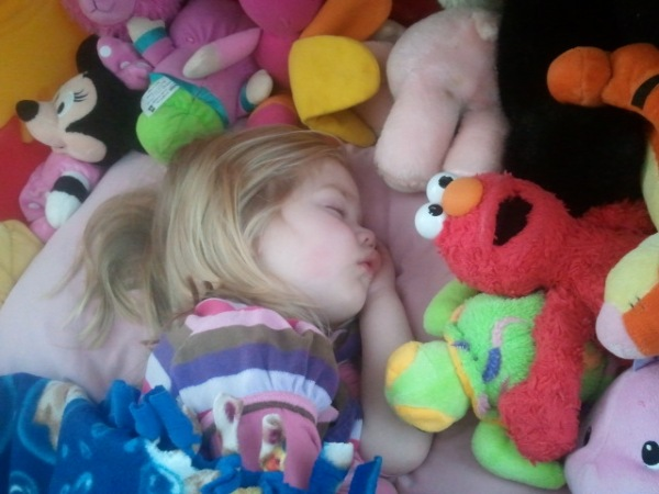 Lauren sleeps, along with all her stuffed animals.