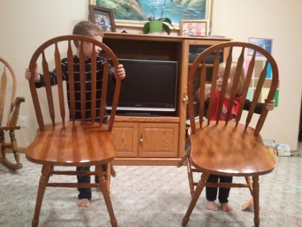 """Jackson and Lauren overturn chairs in the """"temple""""."""