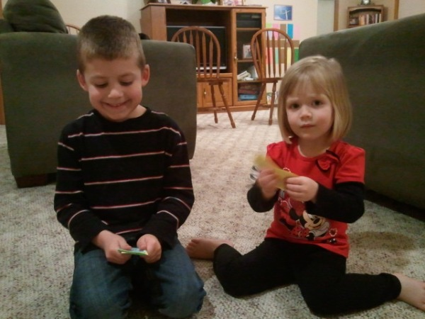 The kids collected all the money scattered in the living room.