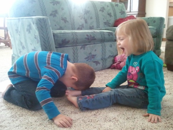 As we acted out Jesus being anointed, we discovered that it tickles to have our feet wiped with someone else's hair! :)