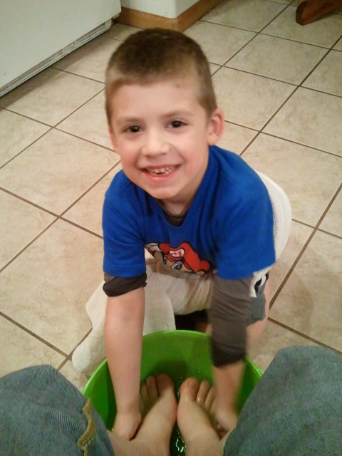 Jackson washes my feet.