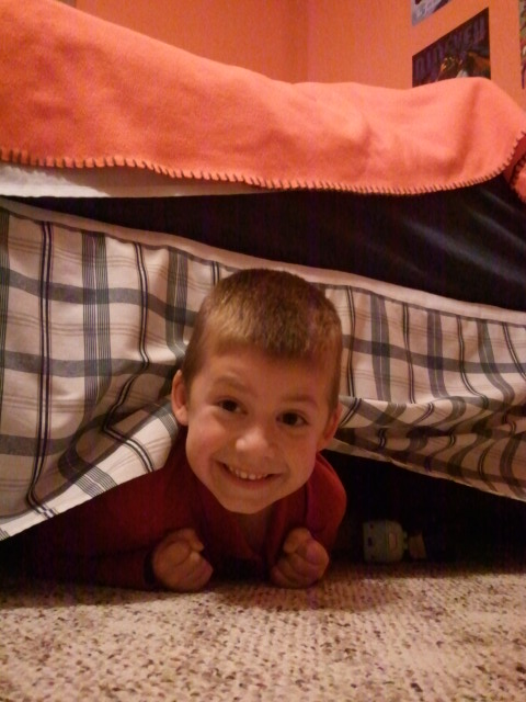 Jackson hides under his bed during our Hide and Go Seek game