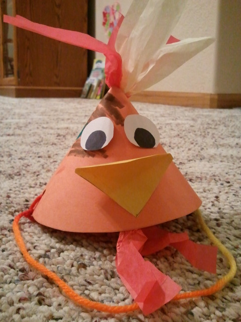 We made rooster hats out of construction paper, tissue paper and string.