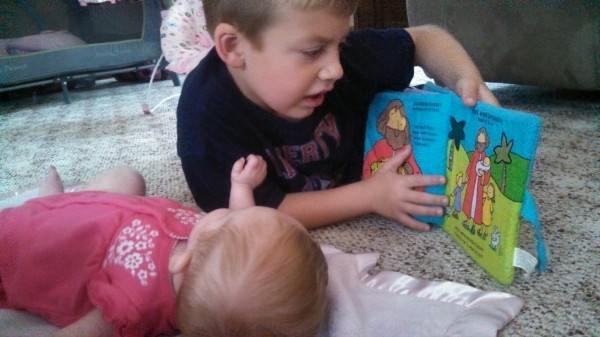 Jackson reads his baby Bible to Maci