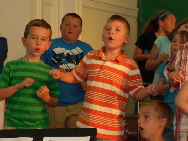 Jackson (in the orange) sings from his heart.