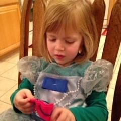 Lauren sews her ornament