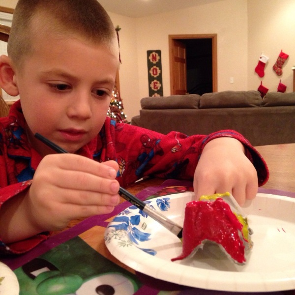 Jackson paints his Bethlehem ornament.