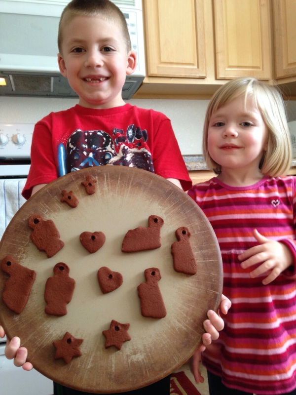 Jackson and Lauren hold their cinnamon ornaments just before baking.