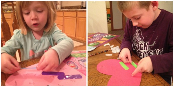 Lauren and Jackson work on their Band-aid Hearts.