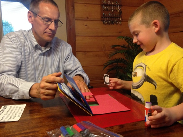 Papa and Jackson build his ABC book.