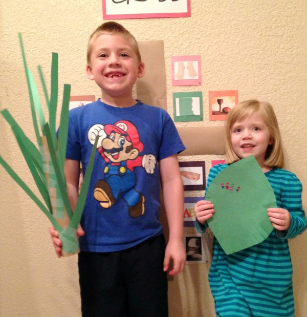 Jackson and Lauren wave their palm branches to celebrate Jesus entering Jerusalem.