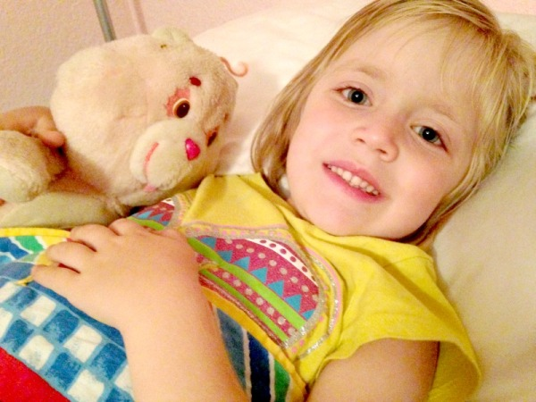 Lauren felt safe from the fireworks snuggled in her own bed with Cheer Bear.