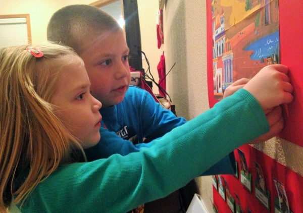 Jackson coaches Lauren as she finds where King David fits on our Journey to the Manger poster.