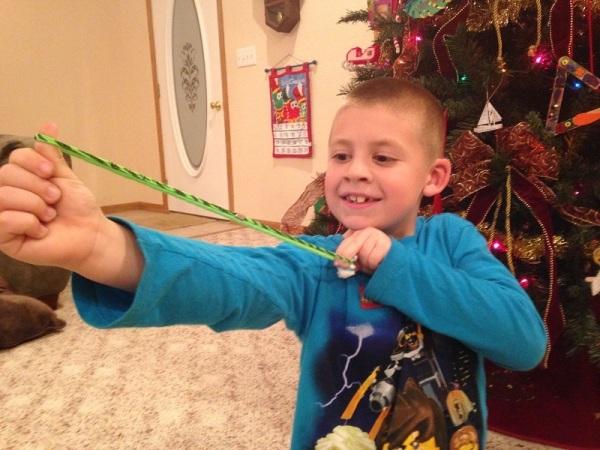 Jackson steadies his slingshot before letting it loose.