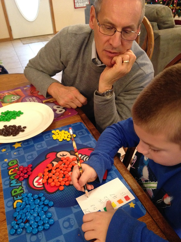 Papa and Jackson tally the final count for our M&M census.