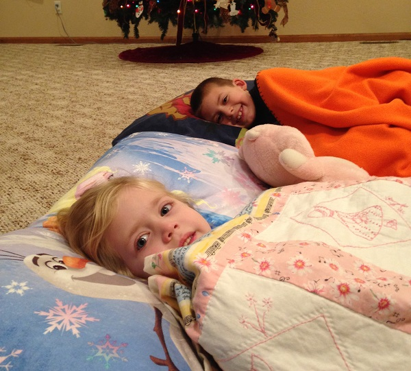 The kids created comfy beds in the living room to think about what it would be like to trade comfort to serve Christ.