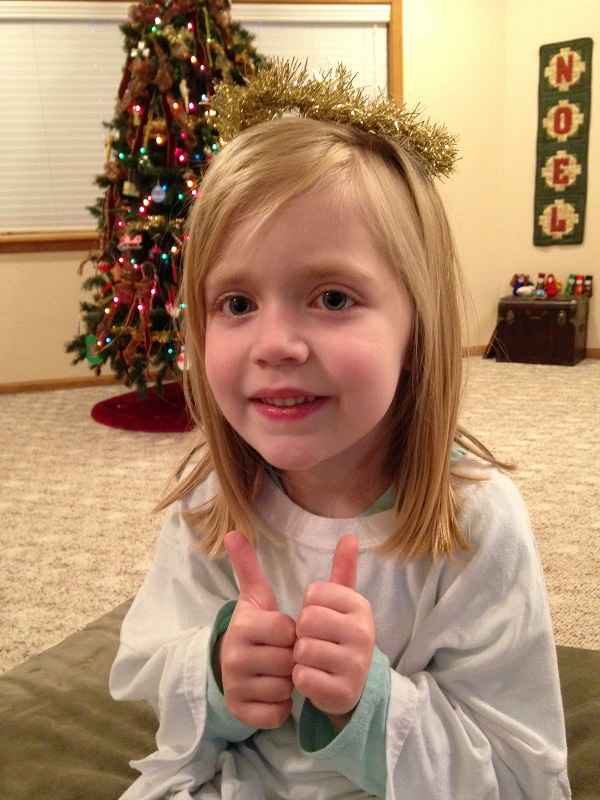 Angel Lauren gives two thumbs-up to share her good news!