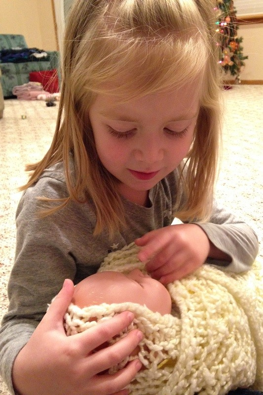 Lauren cradles our baby Jesus in her arms, imagining what it might have been like for the shepherds to see the Messiah.