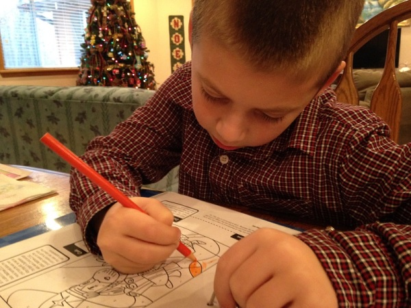 Jackson works on his Journey to the Manger color by number of the Wise Men.