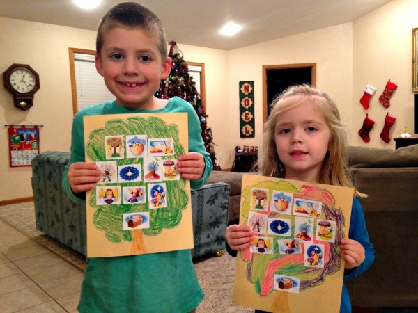 Jackson and Lauren hold up the family trees we made for Jesus.