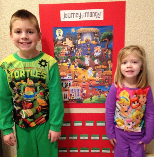 On Christmas morning, Jackson and Lauren stand by our Journey to the Manger calendar, complete with Jesus!