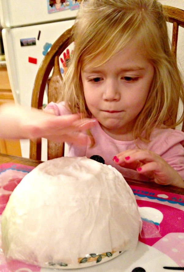 Lauren pats down wet toilet paper to cover a bowl. Though the project wasn't finished today (on purpose!), the kids did get to splash quite a bit of water around.