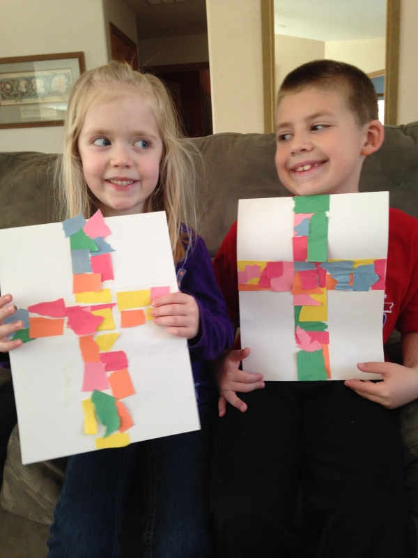 Jackson and Lauren made crosses out of ripped paper pieces