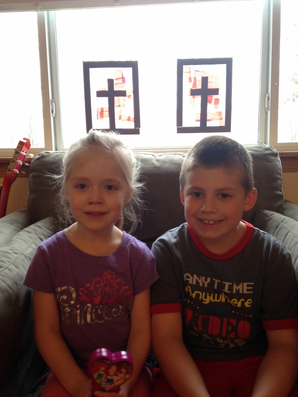 Lauren and Jackson sit under their sun catcher crosses
