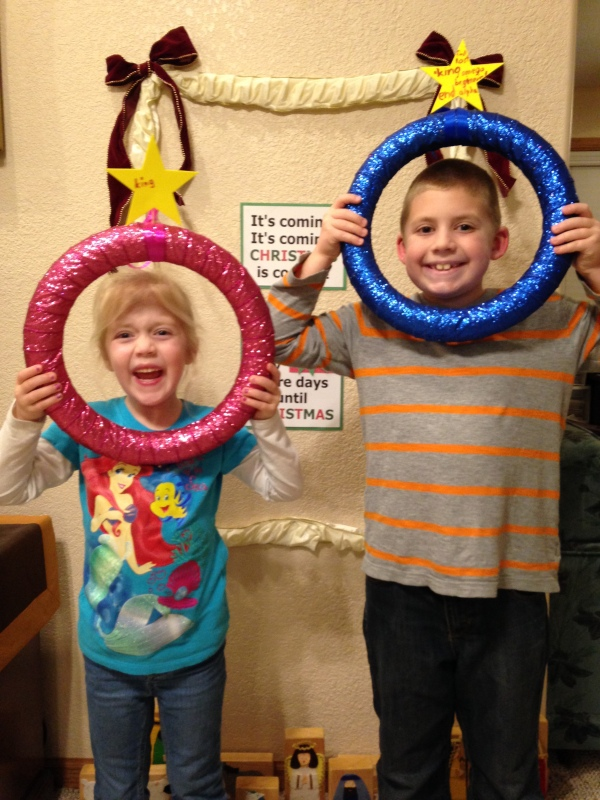 The kids hold up their Advent wreaths, where we will add different names of Jesus from Scripture during the month.