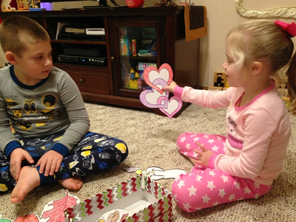 Jackson and Lauren open our present filled with God's promises.